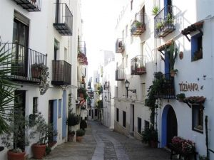 lovely-narrow-street-and-balconies-decorated-with-plants-in-peniscola-spain-john-a-shiron Medium
